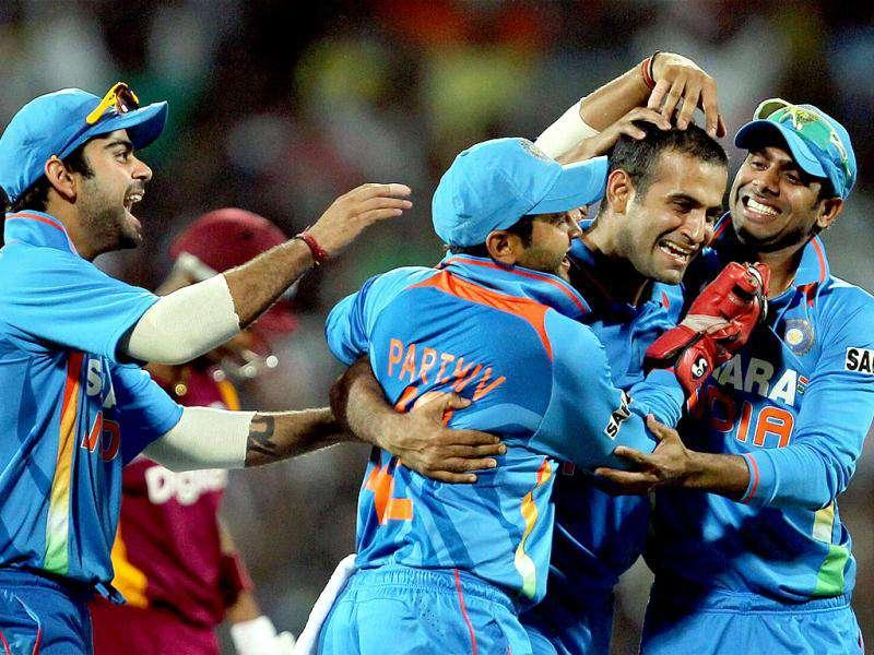 Irfan Pathan along with teammates celebrating the wicket of West Indies' Lendl Simmons during the final ODI cricket match in Chennai.