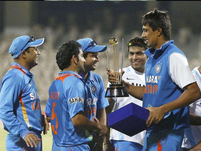 Members of the Indian cricket team are seen with the trophy after their win in the fifth one-day international cricket match against West Indies in Chennai.