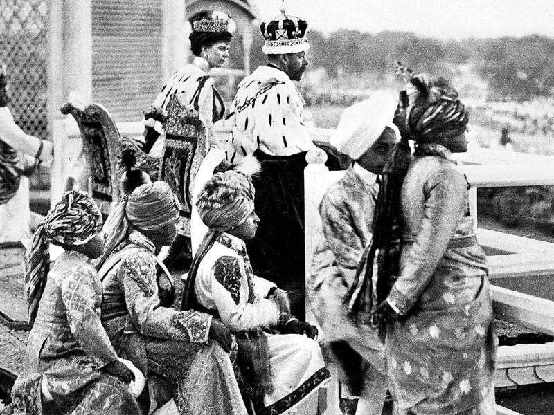 The royal couple: King Emperor George V and Queen Mary observe a show of pageantry from the Red Fort ramparts. In the foreground are decked-up young Indian Princes, who were called 'Pages'. Soon after the Durbar ended, the King, an avid hunter and stamp collector, rushed to the Nepal border on a tiger hunting expedition while the Queen visited Taj Mahal. Photos courtesy: New Delhi: Making of A Capital, Roli Books