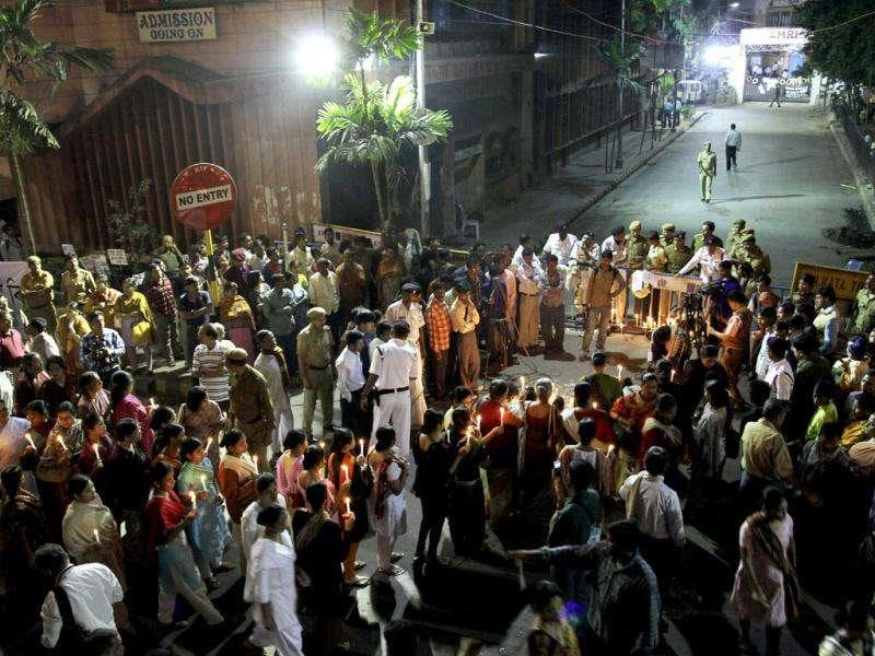 People take out a candle light vigil near the AMRI Hospital in memory of those who died in AMRI tragedy, in Kolkata.