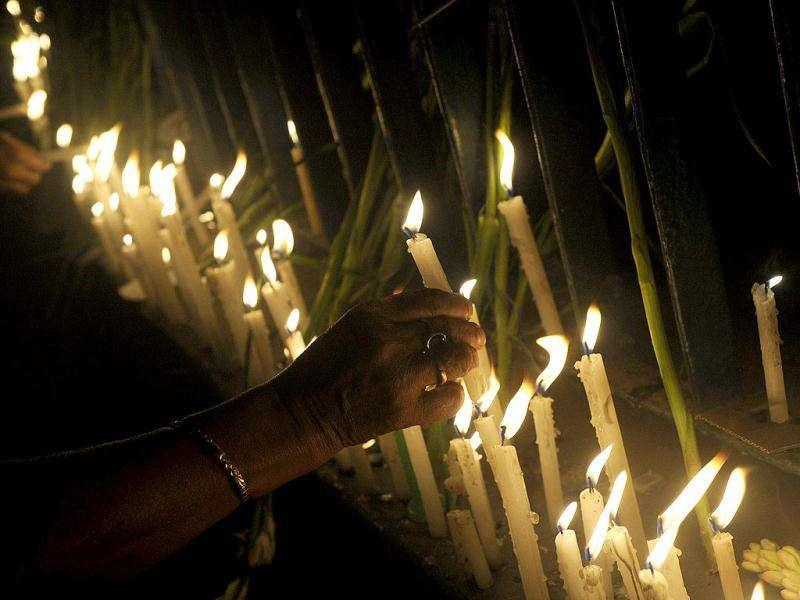 People light candles to pay their respects to the people who lost their lives in the recent fire at the Advanced Medicare And Research Institute (AMRI) hospital in Kolkata.