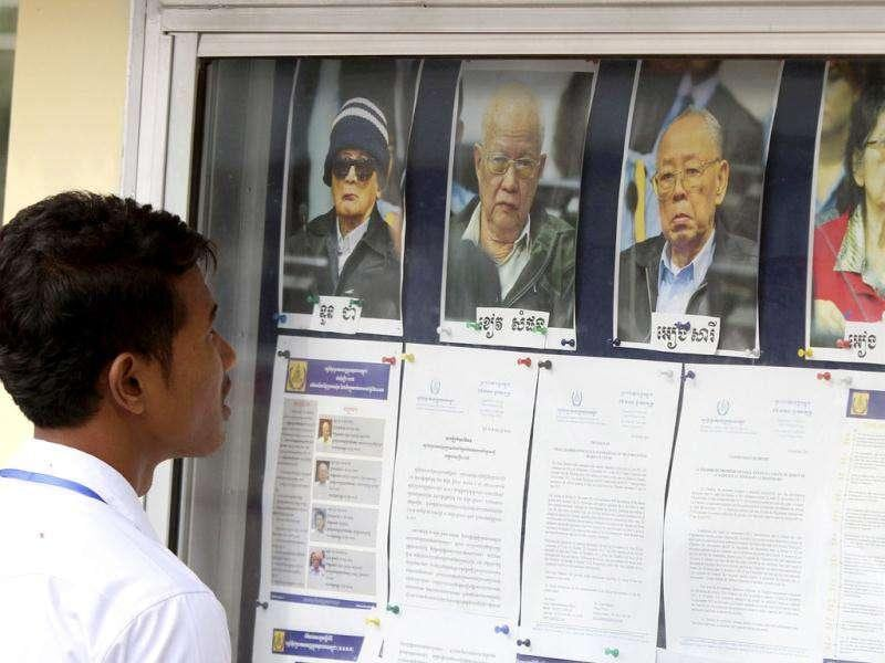 A student looks at portraits of former Khmer Rouge leaders on a bulletin board, before attending their hearing at the Extraordinary Chambers in the Courts of Cambodia (ECCC), on the outskirts of Phnom Penh. Reuters Photo