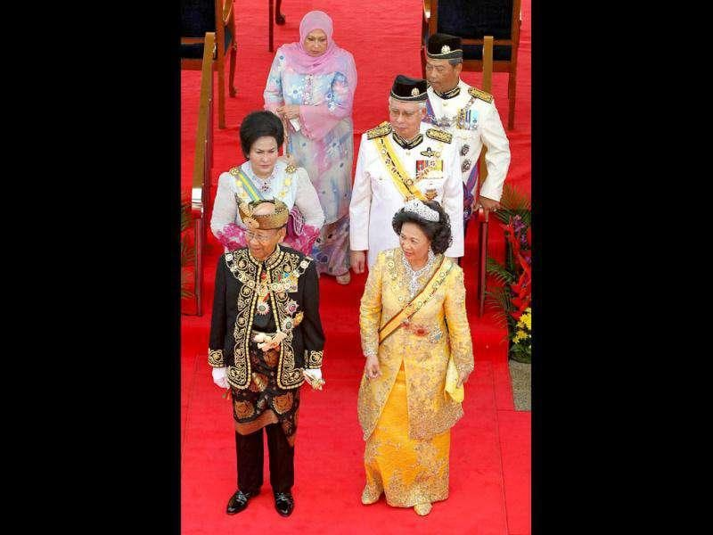 The 14th king of Malaysia, Sultan Abdul Halim Mu'adzam Shah (front L), Queen Sultanah Haminah Hamidun (front R), Malaysia Prime Minister Najib Razak (centre row-R) and deputy minister Muhyiddin Yassin (3rd row-R) and their wives greet officials during the king's welcoming ceremony at the Parliment House in Kuala Lumpur. AFP Photo