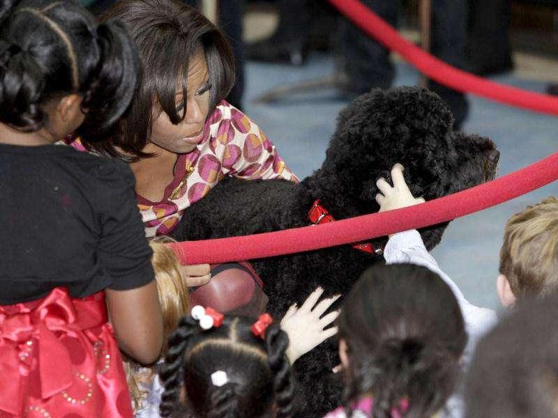 Children pet the Obama family dog Bo as US first lady Michelle Obama holds him at the Children's National Medical Center in Washington. Reuters Photo