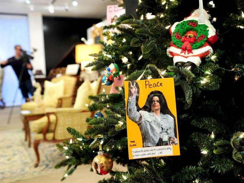 Decorations from fans hang on a Christmas Tree during a press preview for the sale of fine art and furnishings from Michael Jackson's 100 North Carolwood Drive home at Julien's Auctions in Beverly Hills, California. AFP Photo