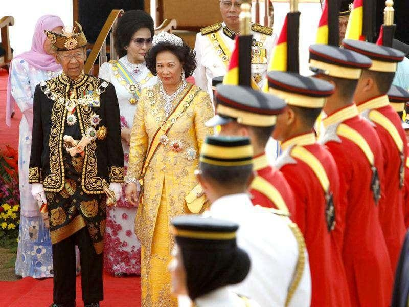 Malaysia's new King Sultan Abdul Halim, front left, Queen Haminah stand on the red carpet during a welcoming ceremony at the Parliament Square in Kuala Lumpur, Malaysia. The 84-year-old sultan became the oldest constitutional monarch in this Southeast Asian nation's history. AP/Vincent Thian