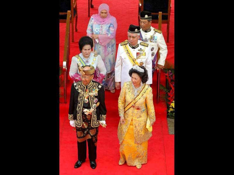 The 14th king of Malaysia, Sultan Abdul Halim Mu'adzam Shah (front L), Queen Sultanah Haminah Hamidun (front R), Malaysia Prime Minister Najib Razak (centre row-R) and Deputy Minister Muhyiddin Yassin (3rd row-R) and their wives greet officials during the king's welcoming ceremony at the Parliment House in Kuala Lumpur.   AFP/Mohd Rasfan