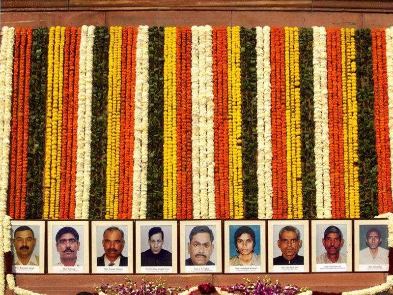 Floral garlands hang above portraits of security officers who lost their lives in the 2001 attack on Parliament during an event to mark the 10th anniversary of the attack, in New Delhi. (AP/Manish Swarup)