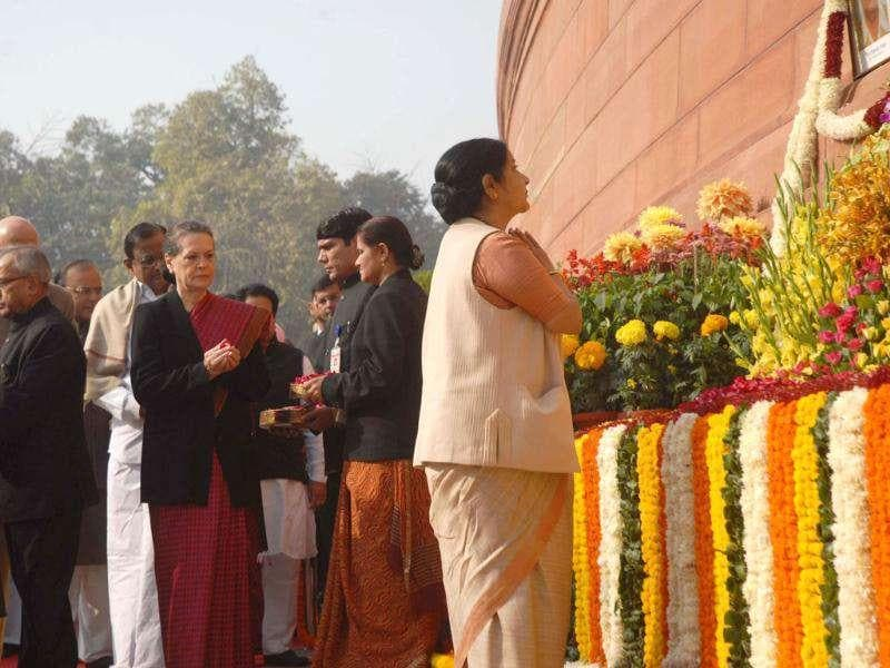 Opposition leader in Lok Sabha Sushma Swaraj and UPA chairperson Sonia Gandhi pay tribute to martyrs who lost their lives in 2001 attck on Parliament, in New Delhi.