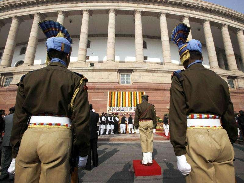 Paramilitary soldiers stand in attention as lawmakers pay their respects to security officers who lost their lives in the 2001 attack on Parliament during an event to mark the 10th anniversary of the attack, in New Delhi. (AP/Manish Swarup)