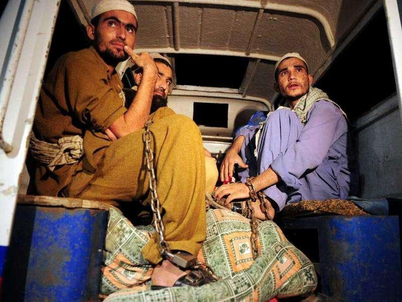 Rescued Pakistani students sit in a police vehicle following a police raid on Madrassa Zakarya in Karachi. Pakistani police rescued 45 students found chained in the basement during a raid on an Islamic seminary in the southern port city of Karachi, police said. According to government records, there are at least 15,148 seminaries in Pakistan with more than two million students -- around five percent of the 34 million children in formal education. AFP PHOTO/ASIF HASSAN
