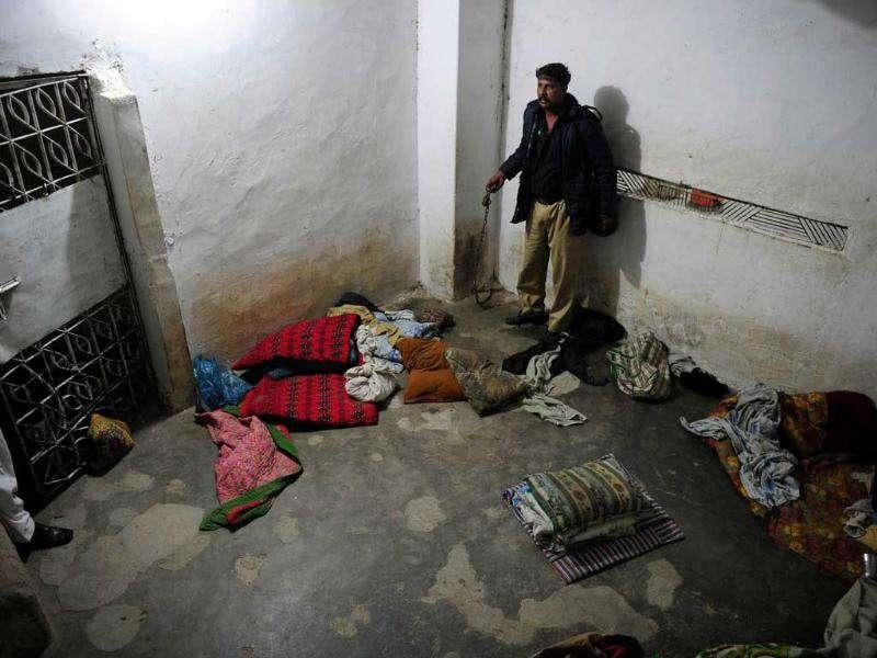A Pakistani policeman searches a basement of Madrassa Zakarya in Karachi. Pakistani police rescued 45 students found chained in the basement during a raid on an Islamic seminary in the southern port city of Karachi, police said. According to government records, there are at least 15,148 seminaries in Pakistan with more than two million students -- around five percent of the 34 million children in formal education. AFP PHOTO / ASIF HASSAN