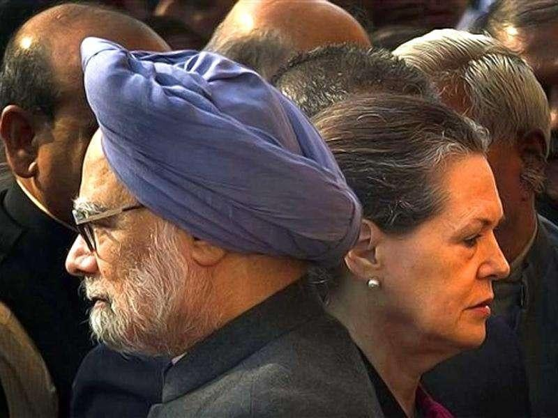 Prime Minister Manmohan Singh, left, and Congress party President Sonia Gandhi, right, attend a function to mark the 10th anniversary of the Parliament attack in New Delhi. Leaders along with security officers paid homage to those who lost their lives in the 2001 terrorist attack on the Parliament.