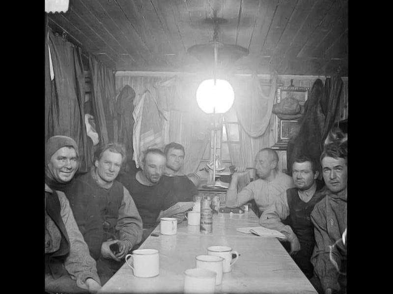 Team members Adolf Lindstrom, Sverre Hassel, Oscar Wisting, Helmer Hanssen, Roald Amundsen, Jorgen Stubberud and Kristian Prestrud sitting around a table at Amundsen's antarctic base called Framheim by the Bay of Whales, Antarctica in 1911. One hundred years ago Norwegian explorer Roald Amundsen won the race to the South Pole in a dramatic and ultimately fatal duel with British adventurer Robert Scott that captured the world's attention. AFP