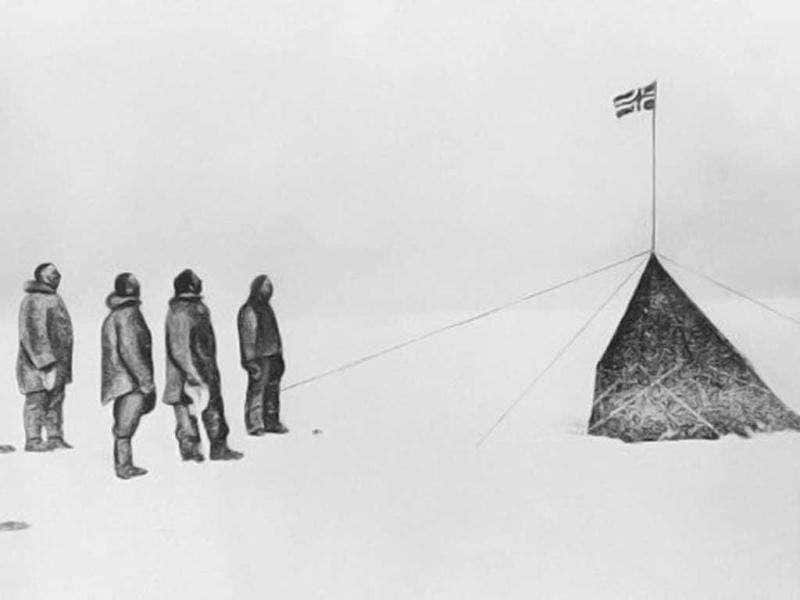 A picture dated 16 December 1911 shows Norwegian explorer Roald Amundsen (1872-1928) and his companions - (L to R) Amundsen, Oscar Wisting, Sverre Hassel and Helmer Hansen - saluting the Norwegian flag at the South Pole they were the first to reach on December 14 with 52 dogs and 4 sledges. AFP