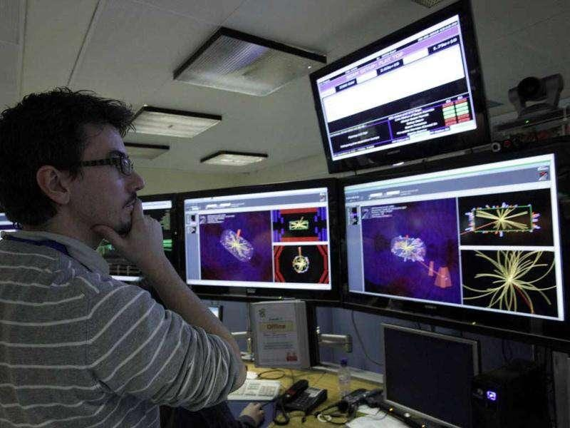 File picture: A scientist looks at the first collisions pictures at full power at the Compact Muon Solenoid (CMS) experience control room at the Large European Organisation for Nuclear Research (CERN) in Meyrin, near Geneva.