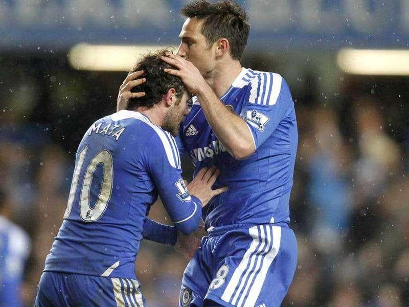 Chelsea's Frank Lampard (R) celebrates scoring his goal with Chelsea's Spanish player Juan Mata during an English Premier League football match between Chelsea and Manchester City at Stamford Bridge in London.