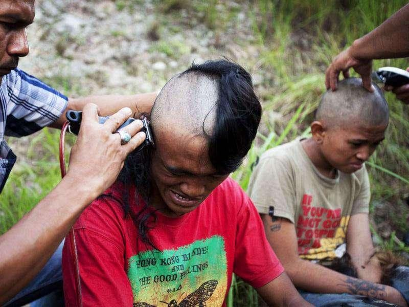 Police shave the hair of detained Indonesian punks at a police school in Aceh province. Sharia police are