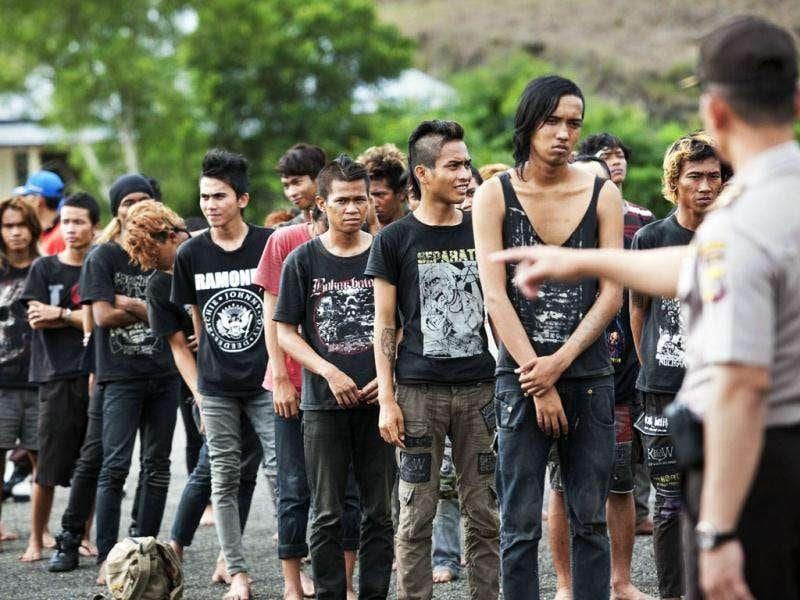Police gather a group of detained Indonesian punks at a police school in Aceh Besar in Aceh province. AFP Photo