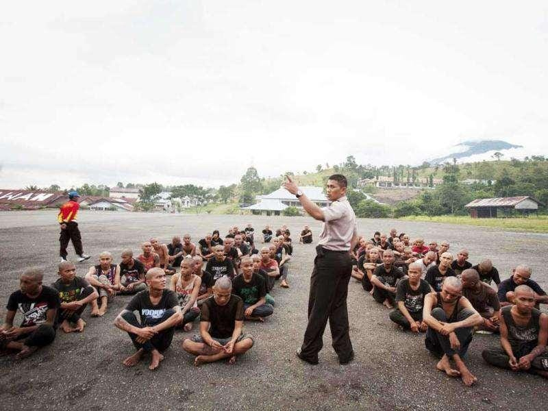 A police officer lectures a group of detained Indonesian punks at a police school in Aceh Besar. AFP Photo