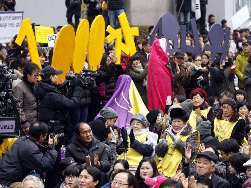 Former South Korean comfort women who were forced to serve for the Japanese Army as sex slaves during World War II are joined by citizens during their 1,000th weekly rally to demand an official apology and compensation from the Japanese government in front of the Japanese Embassy in Seoul. (AP Photo/ Lee Jin-man)