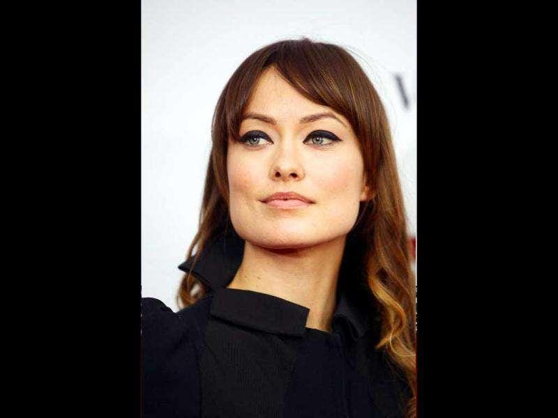 Actor Olivia Wilde looked elegant in a black dress and minimalistic makeup. (Reuters)