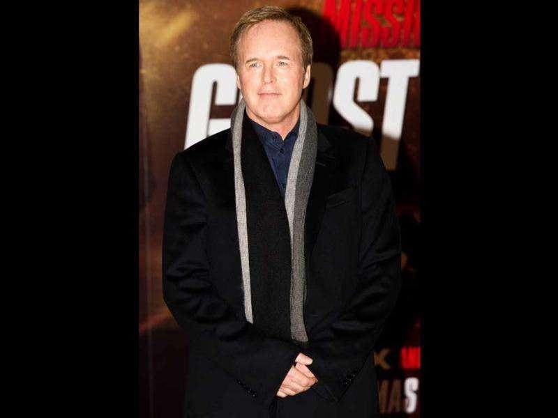 Film director Brad Bird poses for photographers at the UK premiere of Mission: Impossible 4. (AFP)
