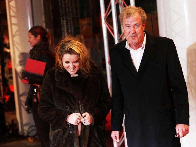 British TV presenter Jeremy Clarkson arrives with his daughter on the red carpet for the UK Premiere of Mission: Impossible Ghost Protocol. (AP)