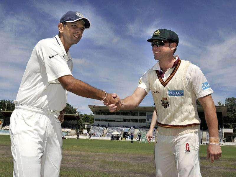 Captain Rahul Dravid (L) shakes hands with his Australian counterpart Ryan Broad on the opening day of a two-day tour match of India vs Cricket Australia Chairman's XI at Manuka Oval in Canberra. AFP Photo