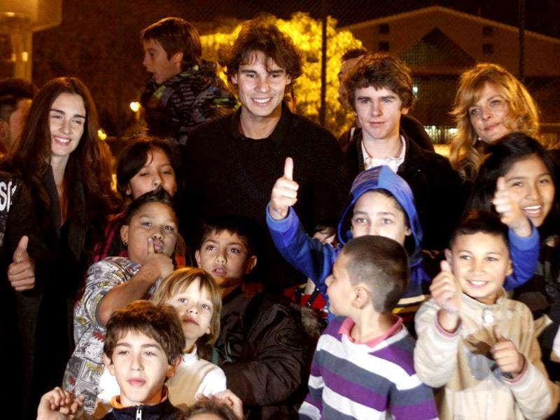 Spanish actress Paz Vega, tennis player Rafael Nadal, British actor Freddie Highmore and German actress Nastassja Kinski (back, L-R) pose with children during the presentation of the 'Integration and Sport' project near Barcelona. Reuters Photo