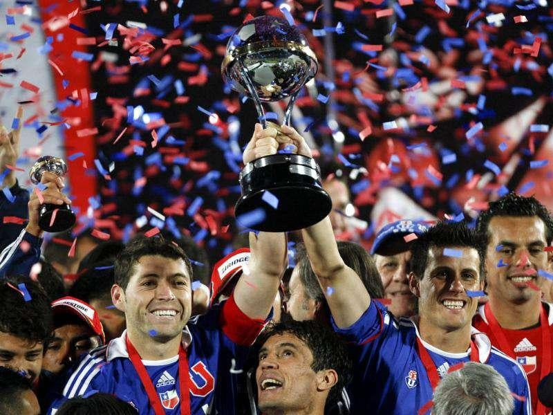 Chile's Universidad de Chile's captain Jose Rojas, left, and Diego Rivarola hold up the trophy at the end of the Copa Sudamericana final soccer match against Ecuador's Liga Deportiva Universitaria in Santiago, Chile. AP Photo
