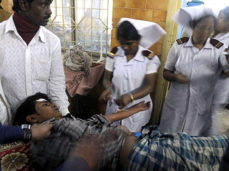 A victim receives medical treatment at the Diamond Harbour hospital, after dozens died and many injured drinking boot-leg liquor in several villages in south of Kolkata.