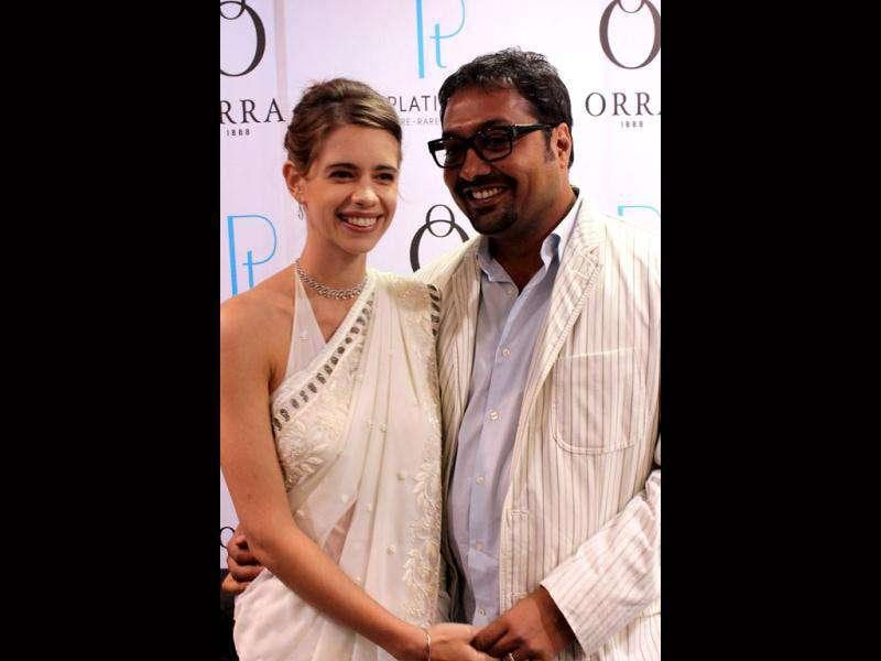 Kalki looked ethereal in a white sari as she posed with husband Anurag Kashyap at a jewellery event.