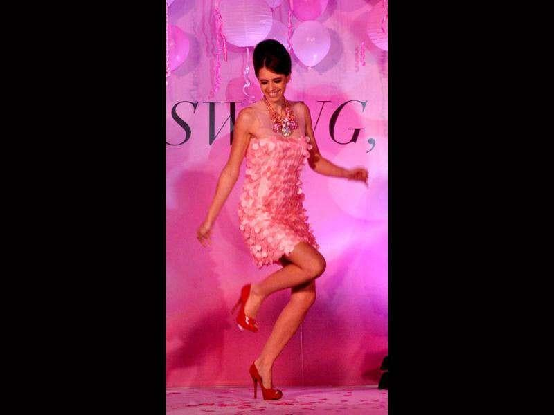 Kalki Koechlin was seen shaking a leg at the launch of the Swarovski 'Swing, Sing and Shine' spring/summer 2012 collection. (AFP)