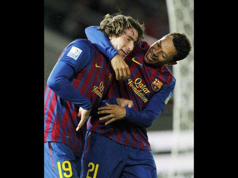 Maxwell (L) of Spain's Barcelona celebrates with teammate Adriano after scoring against Qatar's Al Sadd during their Club World Cup semifinal soccer match in Yokohama, south of Tokyo. Reuters/Kim Kyung-Hoon