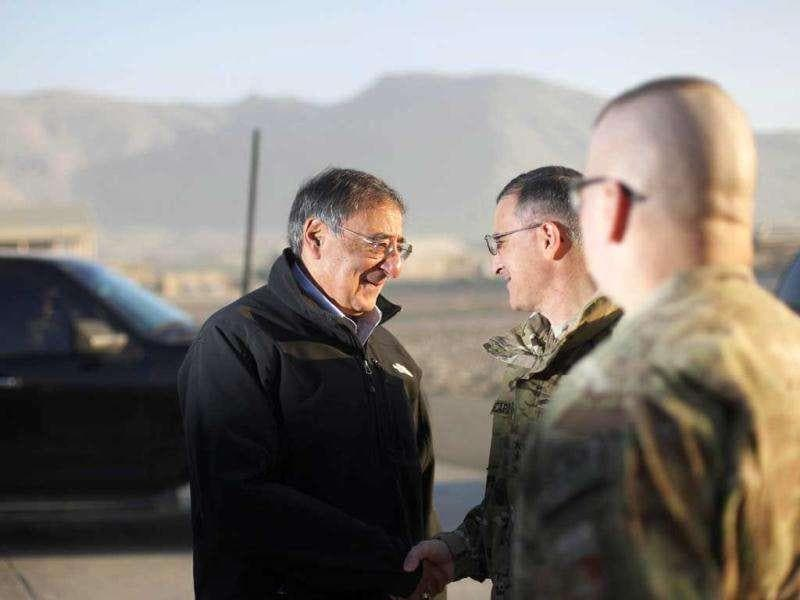 US secretary of defense Leon Panetta (L) shakes hands with Lt. Gen. Curtis M Scaparrotti, Commander of the ISAF Joint Command and Deputy Commander of US Forces in Afghanistan (R) during his departure for Iraq from Kabul, Afghanistan. (AP Photo/Pablo Martinez Monsivais, Pool)