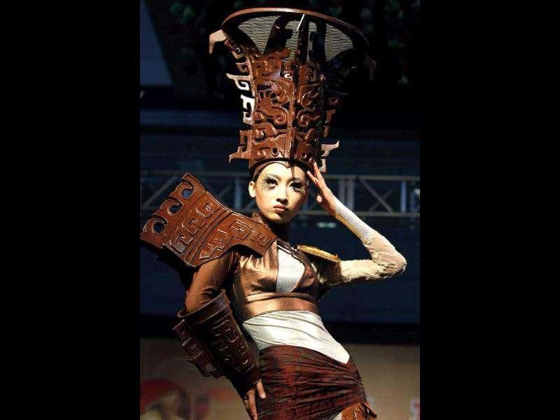 A model presents a creation with adornments partially made of chocolate during a chocolate fashion show by the World Chocolate Wonderland, in Shanghai. The World Chocolate Wonderland will exhibit creations in chocolate such as the Terracotta Warriors and a Chinese dragon when it opens to the public, according to the organiser. REUTERS/Aly Song