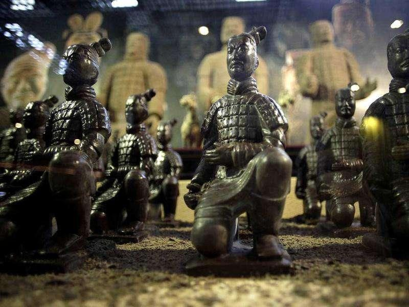 Chocolate-made terracotta warriors are displayed at a new chocolate theme-park in Shanghai, China. AP Photo/Eugene Hoshiko