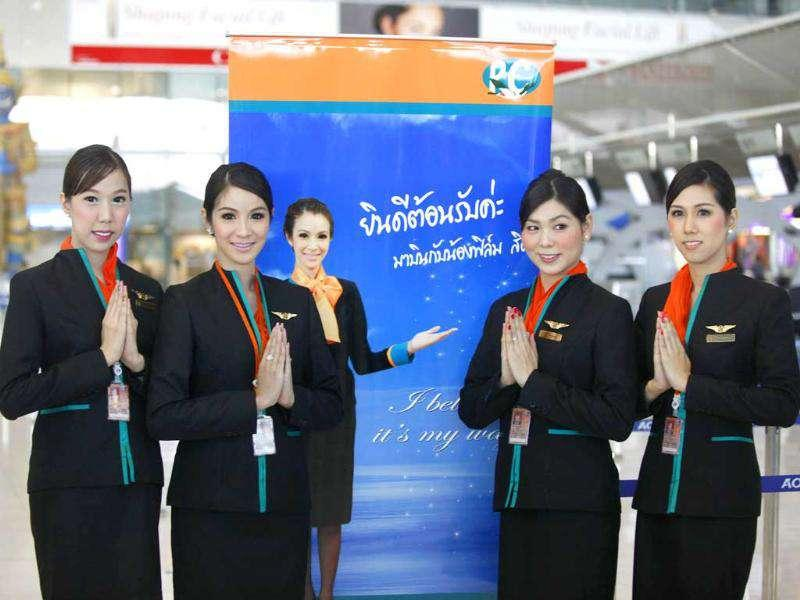 Thai transsexuals flight attendants, from left to right, Chayathisa Nakmai, Dissanai Chitpraphachin, Nathatai Sukkaset and Phuntakarn Sringern pose for photograph at a check-in counter for PC Air at Suvarnabhumi international in Bangkok. AP Photo/Apichart Weerawong.