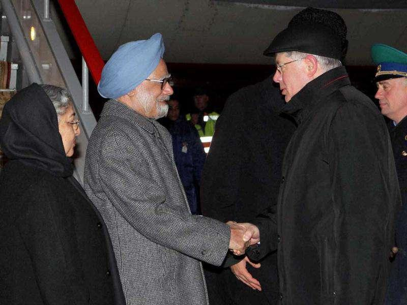 Prime Minister Manmohan Singh and his wife Gursharan Kaur are greeted by Russian deputy foreign minister AM Vadakin at Moscow international airport. PTI/Atul Yadav