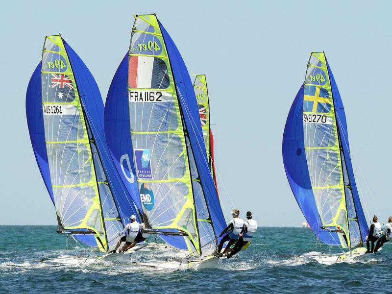 Competitors make a spinnaker run during gold fleet racing in the 49er Men's Skiff at the ISAF World Sailing Championships off Fremantle near Perth.
