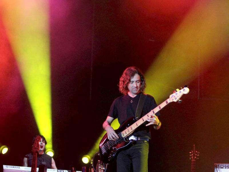 Mexican rock group Mana guitarist Juan Calleros performs during a concert on their Latin America tour at the Jockey Club in Asuncion.
