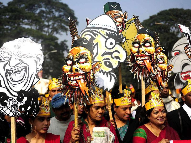 Bangladeshis carry caricatures of war criminals during a rally held to mark the country's 40th Victory Day in Dhaka.