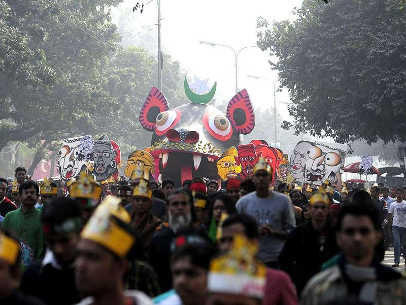 Bangladeshis carry caricatures of war criminals during a rally held to mark the country's 40th Victory Day. Bangladesh won independence from Pakistan after a bitter nine-month war in 1971.