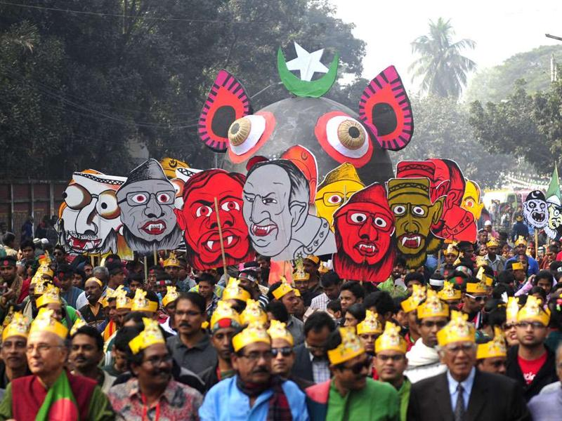 Bangladeshis carry caricatures of war criminals during a rally held to mark the country's 40th Victory Day in Dhaka. Bangladesh won independence from Pakistan after a bitter nine-month war in 1971.