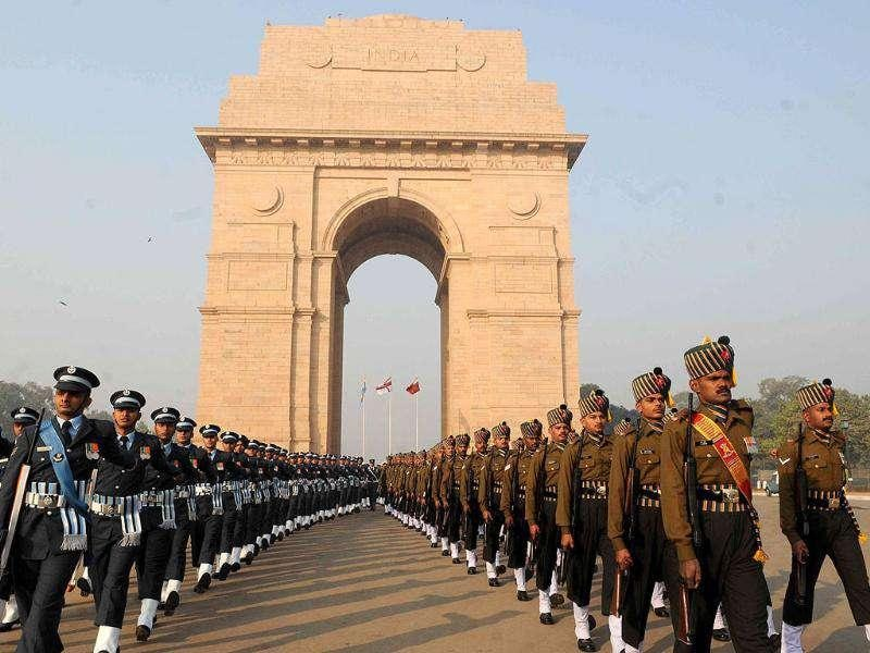 Armed Forces contingents march down across Amar Jawan Jyoti at India Gate to pay homage to mark the Vijay Diwas in New Delhi.