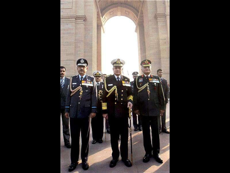 Services' chiefs Air Chief Marshal NAK Browne, Admiral Nirmal Verma and General V K Singh at Amar Jawan Jyoti on the anniversary of 'Vijay Diwas', in New Delhi.