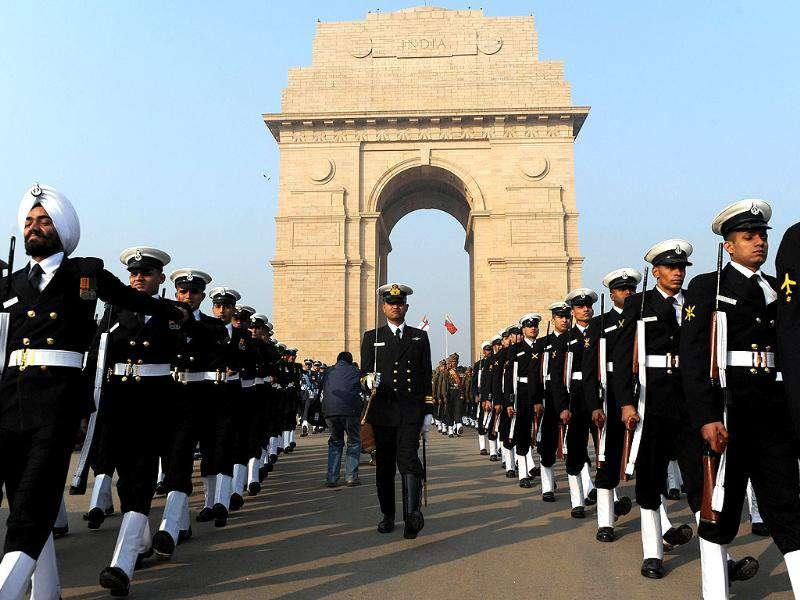 Indian Navy personnel march past India Gate following Vijay Divas celebrations in New Delhi.