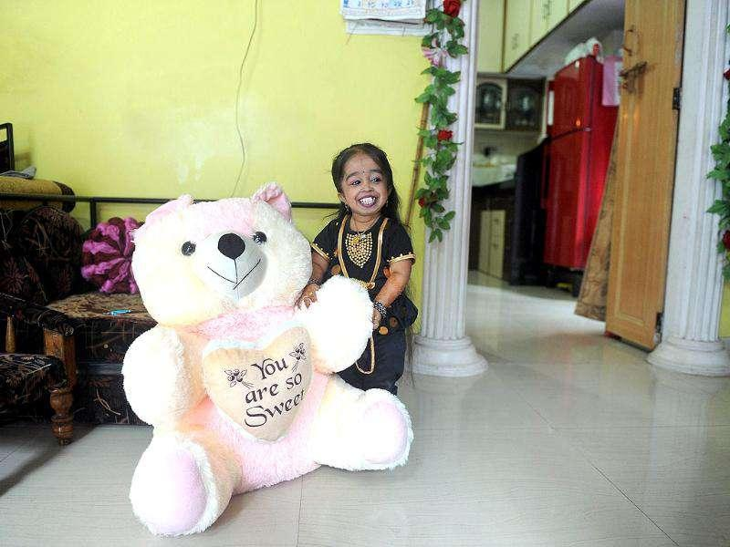 Jyoti Amge, 18, poses at her residence in Nagpur. Amge was officially announced by the Guinness World Records the world's