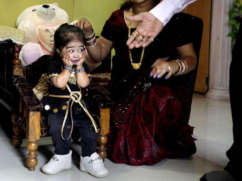 Relatives congratulate Jyoti Amge, 18, who stands at 62.8cm (24.7 inches), before a press conference with Guinness World Records in Nagpur. Amge was officially announced by the Guinness World Records the world's